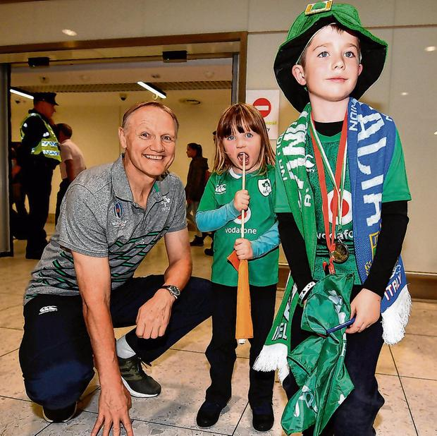 Joe Schmidt is greeted by fans Lauren (4) and Luke (9) Thomas, from Newry, on the Ireland rugby team's return at Dublin Airport. Photo: David Fitzgerald/Sportsfile
