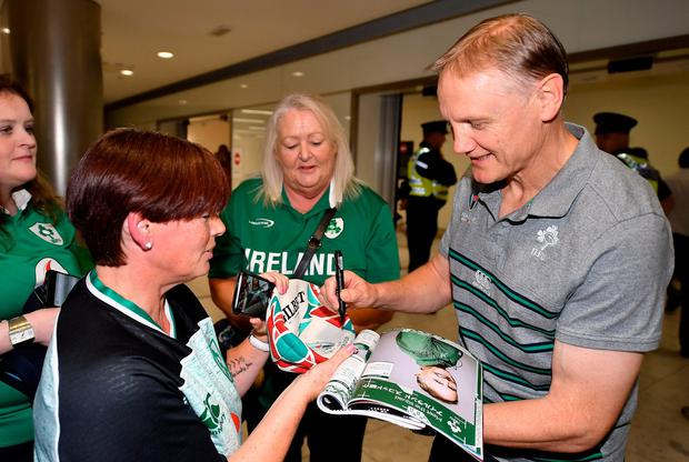 Head coach Joe Schmidt is greeted by supporters on the Ireland Rugby Team's return at Dublin Airport from the Rugby World Cup. Photo: David Fitzgerald/Sportsfile