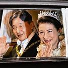 Emperor Naruhito and Empress Masako arrive at the Imperial Palace. Photo: STR/JIJI PRESS/AFP via Getty Images