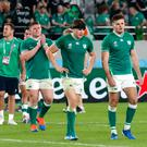 Ireland's players walk on the field after their 46-14 loss to New Zealand in the Rugby World Cup quarterfinal match at Tokyo Stadium in Tokyo, Japan, Saturday, Oct. 19, 2019. (AP Photo/Eugene Hoshiko)