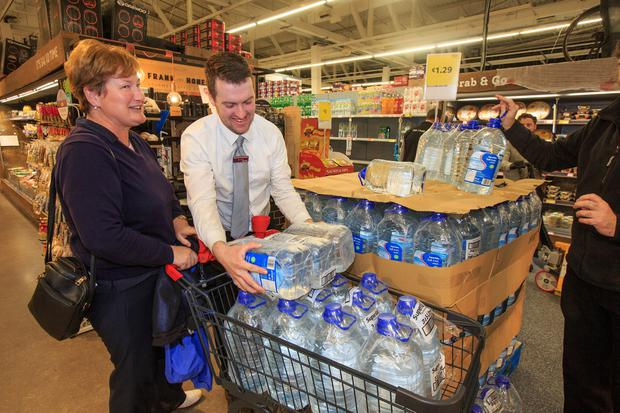 Clear water: Patricia Dillon from Howth buys up bottles at SuperValu, Sutton Cross during last boil water notice