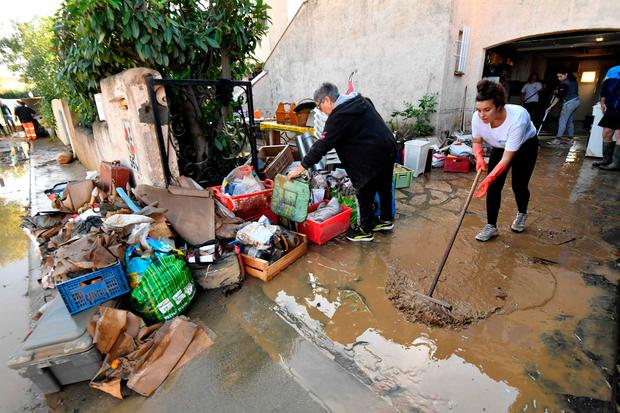 A resident clean her house up the aftermath of powerful storms in Villeneuve-les-Beziers, southern France, on October 24, 2019. (Photo by Pascal GUYOT / AFP) (Photo by PASCAL GUYOT/AFP via Getty Images)