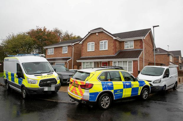 Police outside the arrested Irish couple's house in Warrington