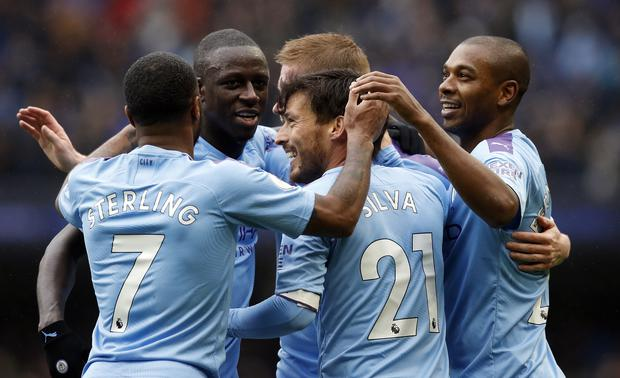Manchester City celebrate the second goal (Martin Rickett/PA)
