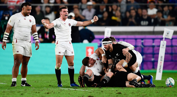 Mako Vunipola and George Ford react to England winning a penalty against New Zealand in yesterday's World Cup semi-final. Photo: Getty Images