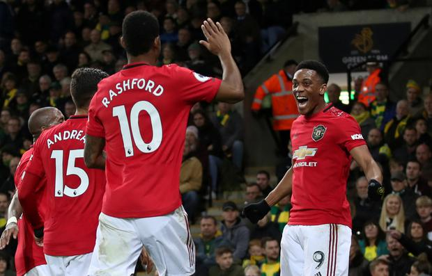 Manchester United's Anthony Martial celebrates scoring their third goal against Norwich with team-mates