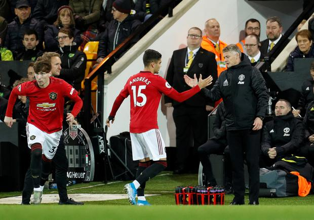 Manchester United's James Garner comes on as a substitute to replace Andreas Pereira who shakes hands with manager Ole Gunnar Solskjaer