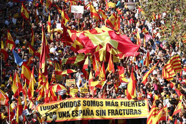 On the streets: Supporters of Spanish unity attend a demonstration to call for co-existence in Catalonia and an end to separatism, in Barcelona, Spain. Photo: REUTERS/Sergio Perez