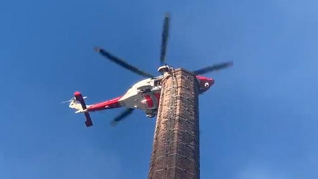 Man left dangling upside-down from 270ft Dixon's Chimney as 'clothes get stuck'