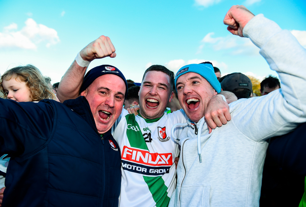 Shane Doyle of Sarsfields celebrates with fans after the team's victory in the Kildare SFC final. Photo: Sportsfile