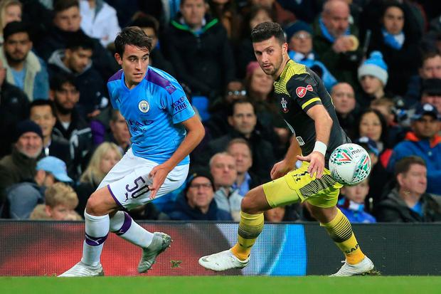 Cup run: Shane Long (right) in action for Southampton against Eric Garcia last night during their 3-1 defeat against Manchester City. Photo: AFP via Getty Images