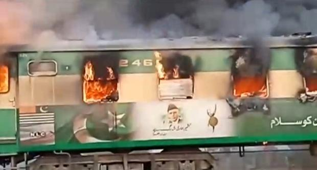 A fire burns a train carriage after a gas canister passengers were using to cook breakfast exploded, near the town of Rahim Yar Khan in the south of Punjab province, Pakistan October 31, 2019, in this still image take from video. Picture: REUTERS/Asghar Bhawalpuri/via REUTERS TV