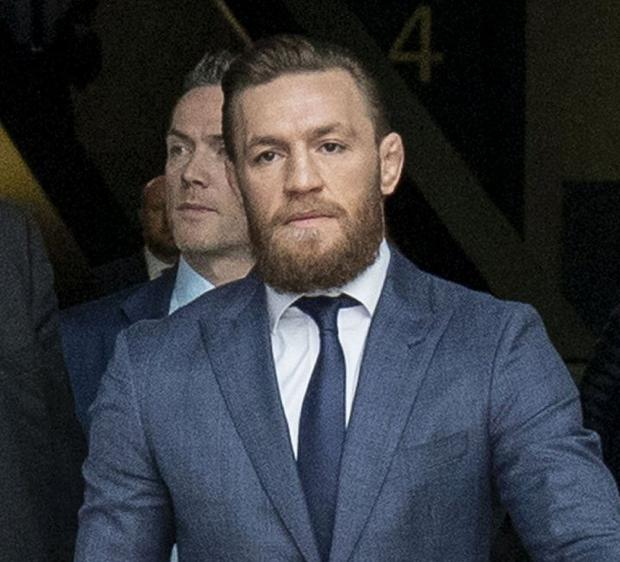 Conor McGregor leaves the court after his conviction yesterday. Photo: Collins Courts