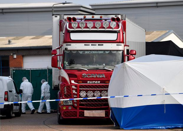 Police search the lorry in which the 39 dead bodies were found