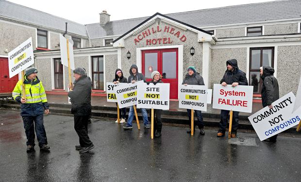 Protest: A 'silent vigil' at the Achill Head Hotel where locals have stated they believe it is unsuitable for asylum seekers. Photo: Conor McKeown