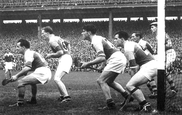 Art Foley leads the Wexford defence as it prepares to face a free from Christy Ring of Cork during the 1956 All-Ireland hurling final