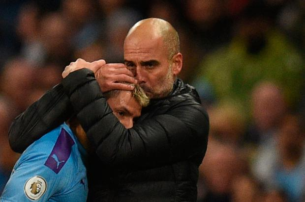 Pep embraces his star striker. Photo: OLI SCARFF/AFP via Getty Images
