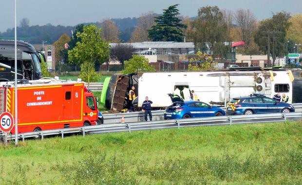 Emergency services are at work on the site of an accident after a bus from the Flixbus company overturned as it took an exit from the A1 motorway, injuring 29 passengers and seriously wounding 4 (Photo by -/AFP via Getty Images)