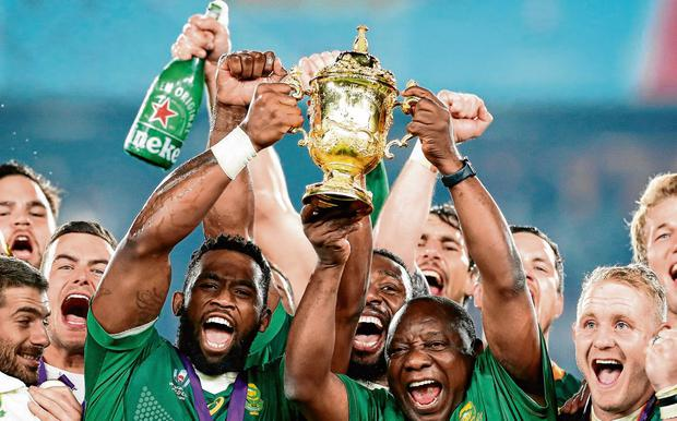 The weight of a nation: Springboks captain Siya Kolisi and South Africa president Cyril Ramaphosa lift the Webb Ellis Cup in Tokyo. Photo: Juan Jose Gasparini/Gallo Images/Getty Images