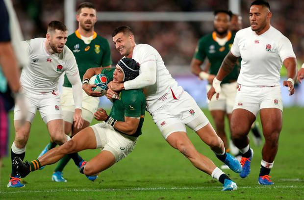 England's Jonny May (right) tackles South Africa's Cheslin Kolbe. Photo: David Davies/PA Wire