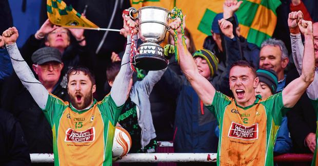 Corofin joint captains Micheál Lundy and Jason Leonard (R) raise the cup after their victory in the Galway final replay against Tuam Stars. Photo: Daire Brennan/Sportsfile