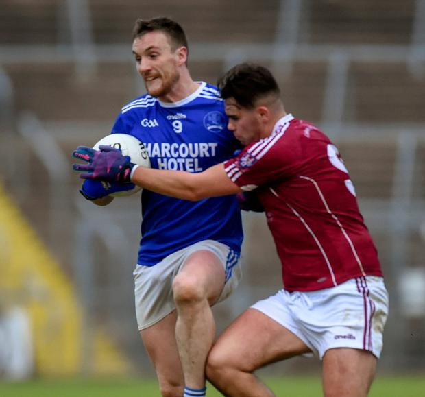 Leo McLoone of Naomh Conaill in action against Cormac Daly of Castlerahan. Photo: Philip Fitzpatrick/Sportsfile