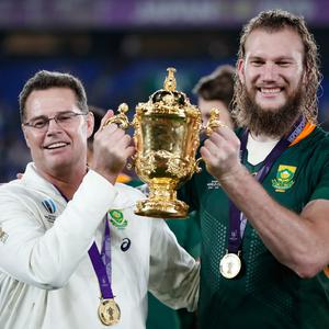 Former Munster head coach Rassie Erasmus and the province's new recruit RG Snyman pose with the Webb Ellis Cup as they celebrate winning the world cup final. REUTERS/Matthew Childs