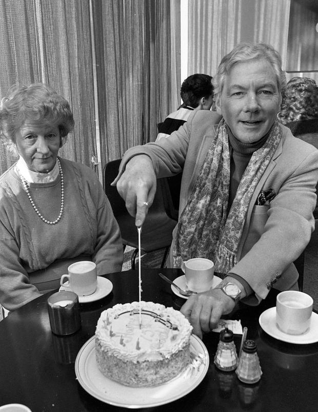 Byrne having cake in Studio 5 on the 15th anniversary of his Radio Show in 1988. Photo: Independent Newspapers Ireland/NLI Collection