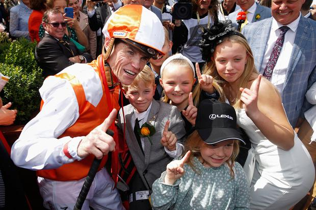 Craig Williams celebrates with family after riding Vow And Declare to win the Lexus Melbourne Cup