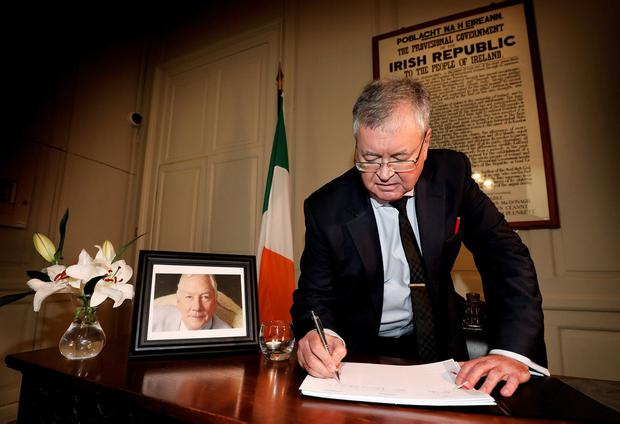 Broadcaster Joe Duffy signs the book of condolence for Gay Byrne. Photo: Steve Humphreys