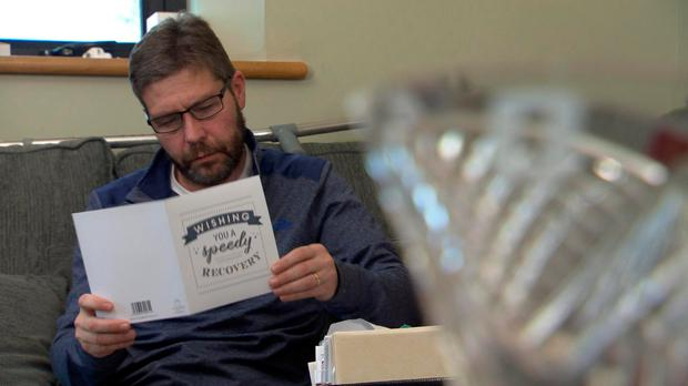Mr Lunney reading a message of support. Photo: BBC Spotlight/BBC/PA Wire