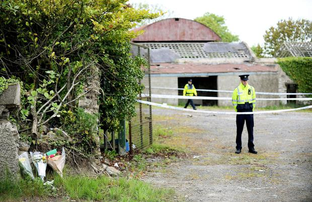 Flowers at the empty farmhouse in Lucan where the body of Ana Kriegel was found. Photo: Caroline Quinn