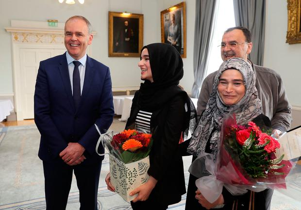 Top marks: Minister Joe McHugh (left) with Suaad Alshleh (second left) and parents Wesam Jouma and Issam Alshleh at the Royal College of Surgeons. Photo: PA