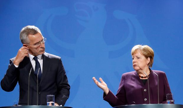 NATO Secretary-General Jens Stoltenberg and German Chancellor Angela Merkel address the media during a news conference in Berlin, Germany, November 7, 2019. Picture: REUTERS/Fabrizio Bensch