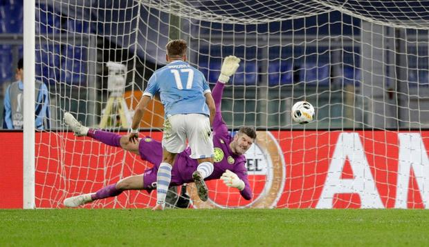 Celtic's goalkeeper Fraser Forster makes a save late on. AP Photo/Gregorio Borgia