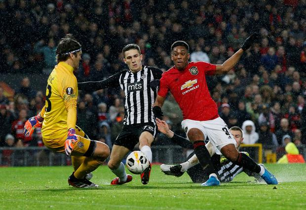 Anthony Martial puts away United's second goal. Photo: REUTERS/Andrew Yates