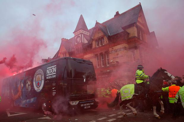 Liverpool fans set off flares and throw missiles at the Manchester City team bus before their Champions League clash at Anfield last year. Photo: Action Images via Reuters