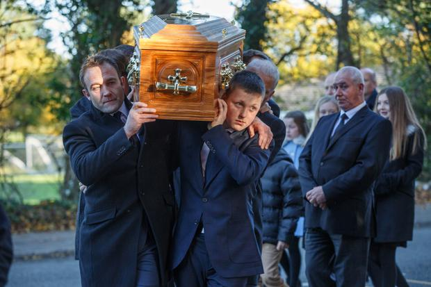 The coffin of broadcaster Gay Byrne is brought to St Fintan's Cemetery after his funeral mass. Pic: Mark Condren