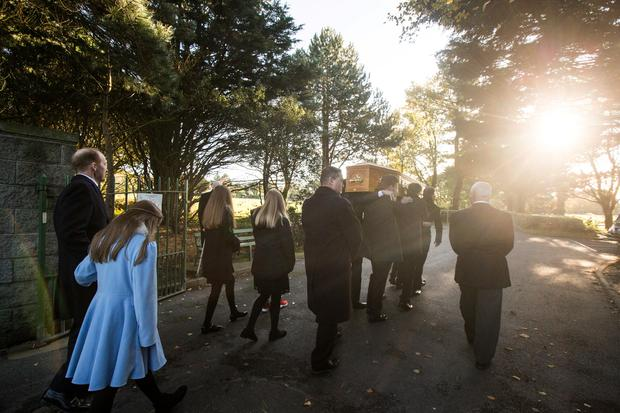 The coffin of broadcaster Gay Byrne is brought to St Fintan's Cemetery after his funeral mass. Picture: Mark Condren