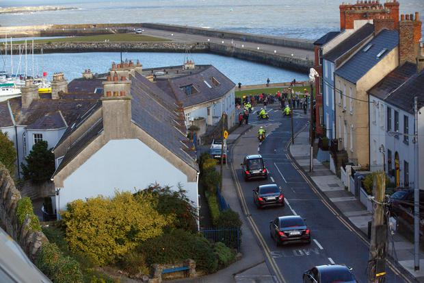 The hearse carrying broadcaster Gay Byrne passes throught Howth. Picture: Mark Condren