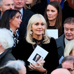 RTE broadcaster Miriam O'Callaghan (centre) among the mourners on the steps of St. Mary's Pro-Cathedral in Dublin following the funeral service of celebrated broadcaster Gay Byrne. Brian Lawless/PA Wire