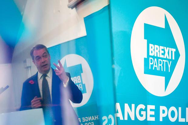 Brexit Party leader Nigel Farage is reflected in a TV monitor while speaking at a campaign rally in Pontypool, Wales. Photo: Ben Birchall/PA Wire