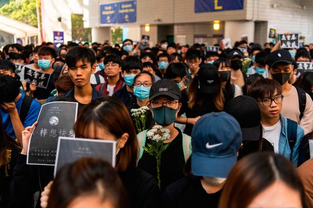 Students attend a ceremony to pay tribute to Chow Tsz-lok, 22, a university student who fell during protests at the weekend and died early on Friday morning, at the Hong Kong University of Science and Technology (HKUST) on November 08, 2019. Photo: Billy H.C. Kwok/Getty Images