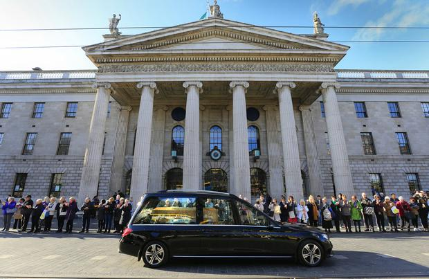 Coffin passes GPO where Gay began his radio career. Pic by Gerry Mooney