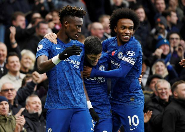 Chelsea's Tammy Abraham celebrates scoring their first goal with Willian and Christian Pulisic
