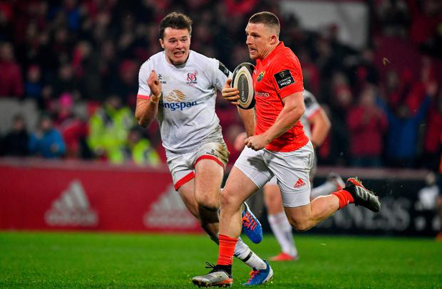 Munster's Andrew Conway races clear of Ulster's Jacob Stockdale on the way to scoring his side's third try during the Guinness PRO14 Round 6 match at Thomond Park in Limerick. Photo: Brendan Moran/Sportsfile
