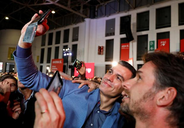 Spanish acting Prime Minister and Socialist Workers' Party (PSOE) leader Pedro Sanchez takes a selfie with a supporter during a campaign closing rally ahead of general election, in Barcelona, Spain November 8, 2019. REUTERS/Rafael Marchante