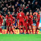 Liverpool's Sadio Mane (centre) celebrates scoring his side's third goal of the game with team-mates during the Premier League match at Anfield, Liverpool.