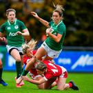 Ireland's Eimear Considine is tackled by Welsh duo Alecs Donovan (left) and Paige Randall during their international at the UCD Bowl. Photo: David Fitzgerald/Sportsfile