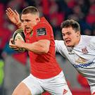 Munster's Andrew Conway, left, breaking past Ulster's Jacob Stockdale on his way to scoring the winning try in last Saturday week's PRO14 clash at Thomond Park. Photo: Brendan Moran/Sportsfile